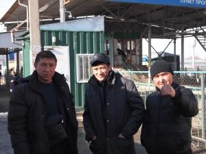 Kyrgyz men at hte border